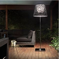 Ktribe F3 outdoor floor lamp. The cool style of Ktribe made just for the outdoors. The Flos Ktribe F3 Outdoor Floor Lamp is suitable for all weather with a braided PVC tube shade (available in a solid Green Wall color or two-toned Panama) and a water-resistant inner polycarbonate diffuser. The stem and base are made of durable die-cast aluminum and steel and coated in gleaming chrome. http://zocko.it/LENEa
