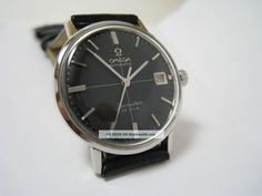 1960's Omega Seamaster De Ville with black crosshair dial. As seen on Don Drapeer's wrist in Mad Men series 6.