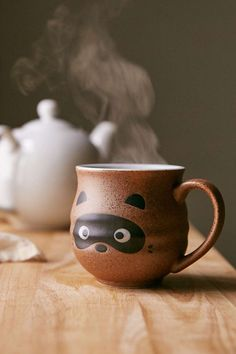 Raccoon Face Mug from Urban Outfitters. Saved to Kitchen needs. Shop more products from Urban Outfitters on Wanelo. Pottery Mugs, Ceramic Pottery, Coffee Love, Coffee Cups, Coffee Art, Brown Coffee, Face Mug, Cute Cups, Cuppa Tea