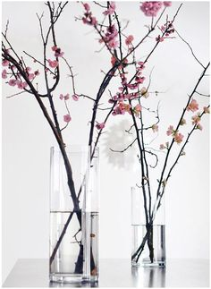 cherry blossoms spread out on desert table with cherry blossom table cloth and filmy silver overlay