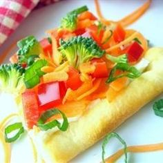 Pre-packaged crescent roll dough gets baked into a single rectangle, then topped with ranch dressing-spiked cream cheese and crunchy vegetables.