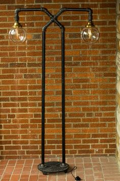 Great idea to reuse old pipes - love the look. http://www.junkyardlighting.com/wp-content/uploads/wpsc/product_images/double%20globe%20x%20lamp%201.jpg