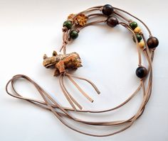Carved rhino, wood, bone and suede necklace by TheWildThings925 on Etsy https://www.etsy.com/listing/216419418/carved-rhino-wood-bone-and-suede