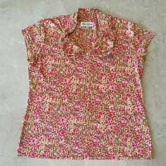 """Floral sports shirt Pre-loved floral design sports shirt. Purchased at Waukee golf course and has """"waikele"""" stitched pn the left side of the shirt but hardly visible. Super comfortable and absorbs moisture during any hot weather. Material is 97% Polyester and 3% Spandex Sport Haley Tops Tees - Short Sleeve"""