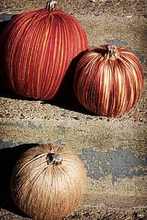 yarn and twine wrapped around those plain foam pumpkins. Cute way to jazz them up.