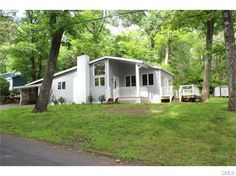 OPEN HOUSE, Sunday, July 12 from 1-3--53 Valley View Lane, New Milford, CT 06776 — Two bedroom contemporary ranch located in lake community at Candlewood Point. Home offers Brazilian cherry floors throughout, Updated cabinets with granite counter tops and stainless steal appliances. Updated bath and laundry room. Wood burning stove. Move right in. Easy walk to the beach!
