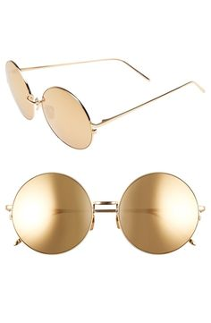 Mirrored metallic lenses vapor-coated with 24-karat gold add showstopping glamour to these rounded, retro-inspired sunglasses finished with 22-karat gold-plated titanium frames.