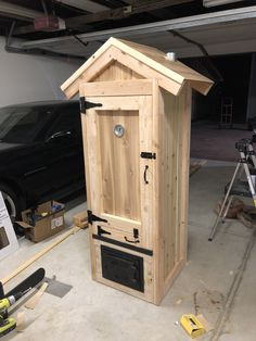 DIY smoker built with a bypass firebox, 5 racks. Cedar for . DIY smoker built with a bypass firebox, 5 racks. Cedar for the paneling, kiln -
