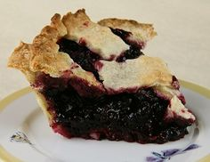 Whoever invented huckleberry pie was a great person! There is absolutely nothing else that tastes quite like a huckleberry pie. It is the ultimate comfort food, especially after you have Pie Recipes, Dessert Recipes, Cooking Recipes, Desserts, Yummy Recipes, Huckleberry Recipes, Huckleberry Cobbler, What To Cook, Sweet Tooth