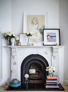 If your fireplace, or the furniture surrounding it, has a far-flung feel, look for hearth accents with an equally worldly vibe. Cast-iron fireplace tools are totally believable as Old World artisanal finds scored abroad, even if they're brand spanking new. If your fireplace gets a ton of use, be sure to keep a container (ideally one that looks great and has a handle for easy carrying) close at hand for collecting all those ashes.
