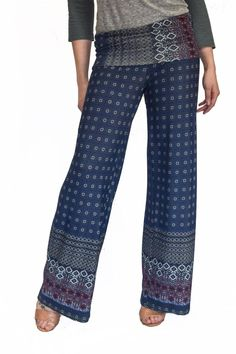 Beautiful and super comfy navy printed palazzo pants.  Pants have navy black gold cream and red in the print.  Pants are fold-over and wide-legged and do have quite a bit of stretch to them.   Printed Palazzo Pants by Gilli. Clothing - Bottoms - Pants & Leggings - Flare & Wide Leg Connecticut