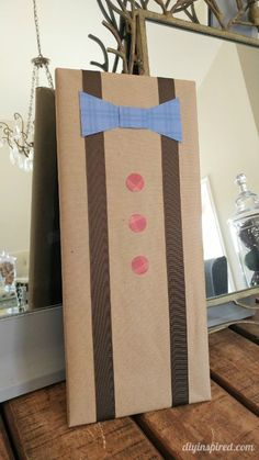 Easy DIY Father's Day Gift Wrapping from Paper Scraps and Ribbon.