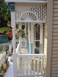 "This is ""The Darling House""Victorian Dollhouse. This house is over the top with layers of white gingerbread from the lattice foundation t..."