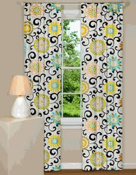 Pom Pon Play Curtains - this site is full of funky decorating ideas, great way to add a pop of color to a room.