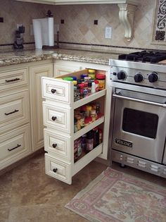 Custom Spice Pullout with false drawer front that match the other side of the range Kitchen Pantry Design, Kitchen Cabinet Storage, Modern Kitchen Cabinets, Modern Kitchen Design, Home Decor Kitchen, Rustic Kitchen, Kitchen Interior, Home Kitchens, Kitchen Island