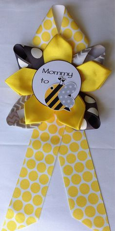 This beautiful Shower Corsage is specialty designed to fit and fulfill your BEE expectations. It is made with yellow, gray with white dots, gray and white