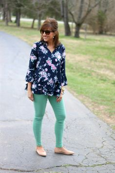 Floral top with mint pants. This outfit is perfect for spring.