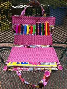 crayon & colouring book tote.  redirects to actual tutorial - but the actual tutorial used scary fabrics and was horribly clashy to me.  This one is cuter :D