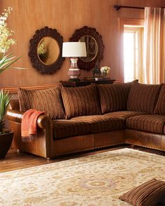 """Striped Sectional Sofa by Old Hickory Tannery at Horchow. Shown: Left-arm sofa and right-arm chaise. Also available: Right-arm sofa and left-arm chaise. Smooth leather with chenille cushions and nailhead trim. Dark brown finish over maple frame. Includes accent pillows, as shown. Overall, 41""""H x 102""""W x 43""""D"""