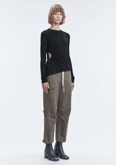 RUCHED CUTOUT SWEATER -  Knit merino long sleeve sweater with drawstring ruched detail at wearer's right side seam. -Crewneck -Fitted at the top and through the sleeves -Relaxed at the hem -100% Superfine Merino -True to size