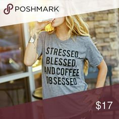 """(new) coffee obsessed tee This brand new *stressed, blessed, and coffee obsessed* design is hot! Shirt 60% combed ring-spun cotton/40% polyester made for a high quality & comfortable fit!  •This is a custom print shirt, made per order. (Please allow 1 business day for production  prior to shipping each order.)   •Available shirt colors: Black, White, Blue, Grey, Red  •Pre Shrunk.       •No tags  •Armpit to armpit measurements: S 18"""" 1/2 , M 19""""       3/4 , L 22"""" , XL 23"""" 1/4 shipped in the…"""