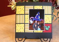 Simple Disney layout with patterned paper squares for background