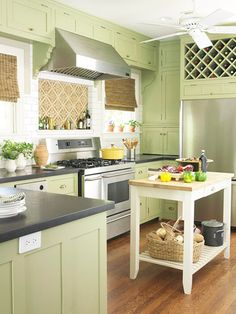 Mint green kitchen cabinets with black counters  Better Homes and Gardens.