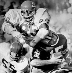 """Buck Buchanan #86 (DT)   The first player drafted by the AFL -- he went to the K.C. Chiefs in 1963 out of Grambling -- the fast, ferocious 6' 7"""", 270-pound Hall of Fame defensive tackle swatted down 16 passes in 1967 and later played in two Super Bowls.        Read More: http://sportsillustrated.cnn.com/multimedia/photo_gallery/1008/nfl.best.players.by.jersey.number.50-99/content.37.html#ixzz2QjgjSEhR"""