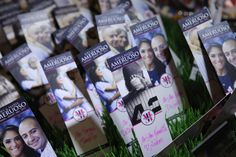 Ok, how great are these escort cards: Baseball tickets with the couple's engagement photo shoot images! The table numbers corresponded with a famous New York Yankee player's number! Love these by Screaming Lunatic Designs!