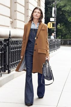 camel coat, chambray shirt, denim flared overalls and a simple satchel #style #fashion