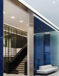 The stunning feature wall and staircase connecting Savills double-height reception hall to the first floor client area. Photography credit: Tim Soar