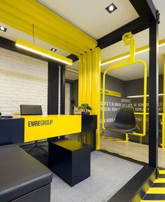 Black and Yellow Emre Group Office Interior - InteriorZine