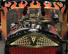 Flames and pinstriping on hot rods at the 53rd Cavalcade of Customs in Cincinnati.