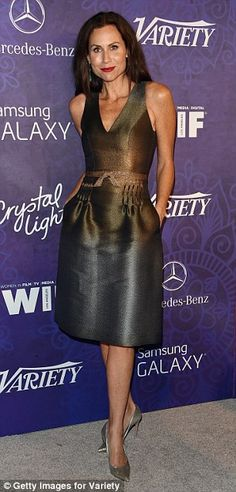 Metallic: Anne Heche and Minnie Driver went for brassy ensembles...
