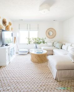 A coastal inspired den with a linen sectional, Benjamin Moore Simply White walls, and cane and rattan accents. Decor, Spring Home Decor, Ikea Storage Cubes, Tv Stand Designs, Linen Sectional, Family Living Rooms, Living Room Design Decor, Paint Colors For Living Room, Large Storage Cabinets