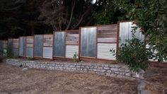 My new fence utilizing corrugated metal and repurposed redwood from the old fence