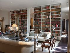 Tufted sofas and bookcases
