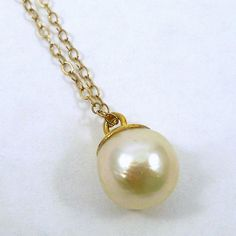 Pearl Drop Pendant on a 14k Yellow Gold Chain. $200