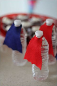 Superhero Birthday Party Ideas for Boys - Make little capes for water bottles! Great for a summertime birthday to keep the kids hydrated.
