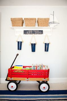 Wagon for book or toy storage...love this idea for a child's room or a speech therapy office!