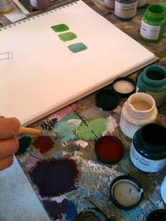 Mixing paint on my table.