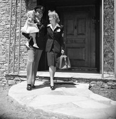 Ronald Reagan is shown with his actress wife, Jane Wyman, and his 1-year-old daughter, Maureen Elizabeth, upon leaving his Beverly Hills home to assume active duty as a lieutenant with the Cavalry of the U.S. Army.