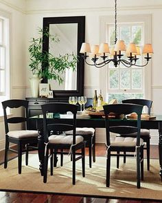 Love the dark furniture, mirror, and chandelier