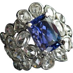 ONLY $2500 during RED TAG SALE! There are simply not enough words to describe the extreme magnificence of this fine estate vintage ring! Set with a large 5.32ct natural Tanzanite,