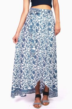 """Statement maxi skirt with floral vine print and a wrap-around adjustable fit. *Hand Wash Cold *100% Rayon/ Contrast: 100% Polyester *42""""/107cm Top to Bottom - Measured on a size M (Model is 5'10/weari"""