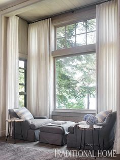 Two swivel chairs and an ottoman create a cozy reading spot. - Photo: Emily Jenkins Followill / Design: Beth Webb