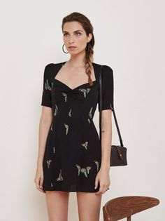 Let your legs out. This is a short sleeve, fit and flare dress with a sweetheart neckline and puff shoulder sleeve.