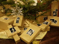 Cute way to wrap presents this Christmas: use b/w (baby) pictures instead of tags, on craft paper.