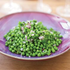 Spring Peas with Mint | Vinegary dishes and wine can be a terrible combination. But the sharp chopped red onion Mark Ladner tosses with these tangy peas makes the recipe delicious with a lightly tannic red.