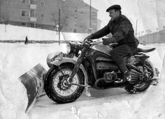 The motorcycle snow plow.  Traction could be a problem.